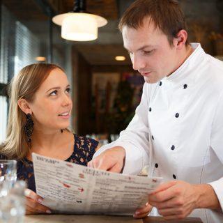 Chef discussing menu regarding food allergies