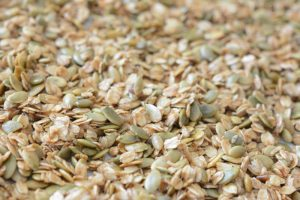 Toasting oats and seeds for making Toasted Coconut and Pumpkin Seed Granola