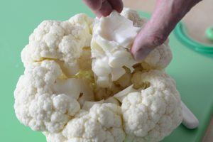 Removing the stem from the cauliflower