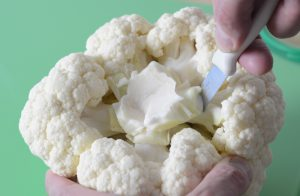 Cutting out the stem from the cauliflower