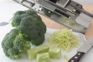 using a mandoline to slice broccoli stems