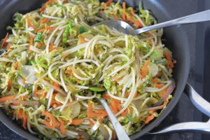 serving shaved Brussels sprouts and spaghetti stir-fry